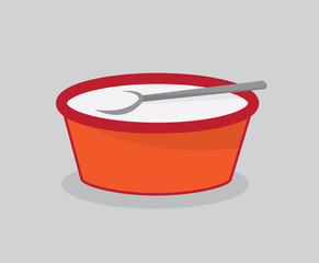 Bowl of milk for cereal with spoon