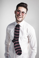 sexy man dressed elegant with s sock tie laughing