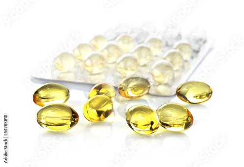 fish oil capsules and blister pack isolated on white background
