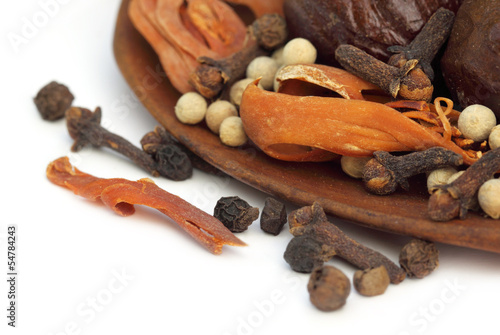 Indian spices over white background