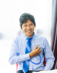 business man with stethoscope checking himself