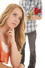 Girl sit close guy behind with flowers