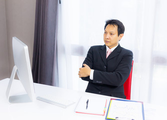 business man looking with desktop computer