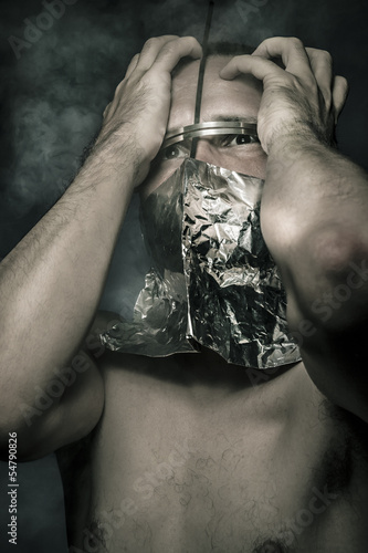 Mist, concept of fear and terror, naked man with hardware in the