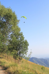 Paragliding on the mountain slope