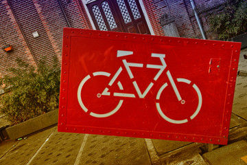 Giant red bike sign in the heart of Amsterdam
