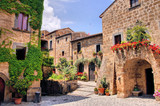 Fototapety Picturesque corner of a quaint hill town in Italy