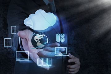 Businessman hand shows a Cloud Computing diagram