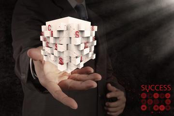 businessman hand shows box of business success chart
