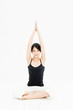 attractive asian woman exercising on white background