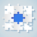 Paper puzzle with a blue the middle for business concepts