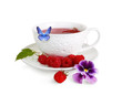 A cup with a fragrant tea and butterfly