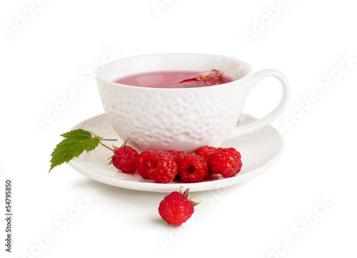 White mug of tea and raspberry
