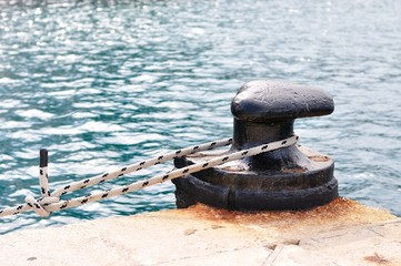 Marine rope on mooring bollard in port of Podgora, Croatia