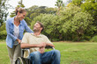 Smiling man in wheelchair talking with partner