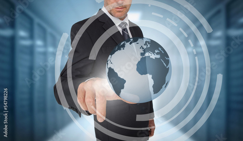Businessman touching earth on futuristic interface