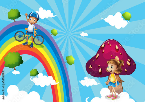 A boy biking in the rainbows