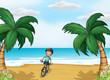 A boy biking at the beach
