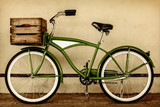 Fototapety Retro styled sepia image of a vintage bicycle with wooden crate
