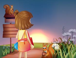 A little girl with a shoulder bag