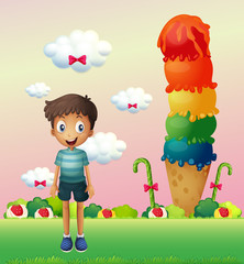 A boy standing near the big ice cream