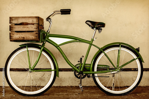 Deurstickers Fiets Retro styled sepia image of a vintage bicycle with wooden crate