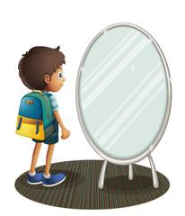 A boy facing the mirror