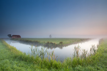 calm summer misty morning over river