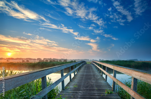 charming wooden bridge over river