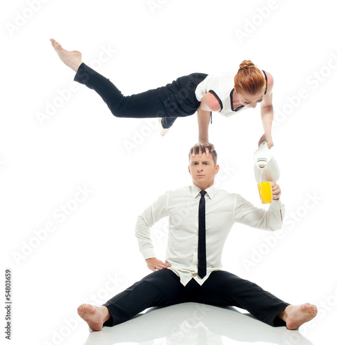 Concept of multi-tasking - businessmen-acrobats