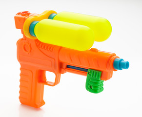 multicolor child water gun, isolated on white