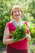 Mature woman with  dill and parsley