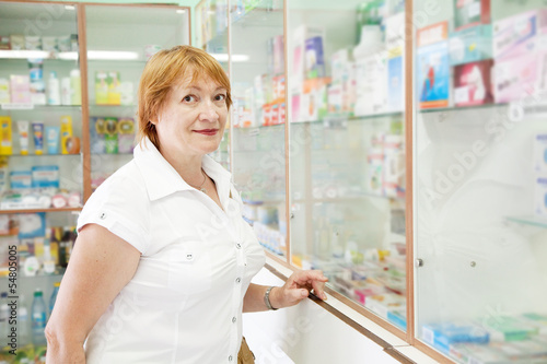 Mature woman in pharmacy