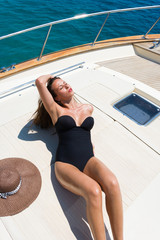 Young woman on her private yacht