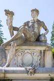 Stone male statue in Peles castle garden, Sinaia, Romania poster