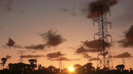 Electricity pillars, timelapse sunrise