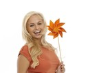 Happy woman holding pinwheel