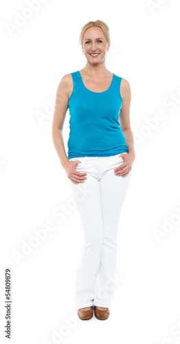 Woman in sleeveless top posing in style