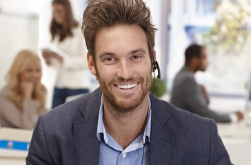 Closeup portrait of happy male dispatcher