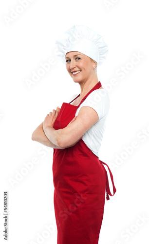 Cheerful confident female chef