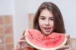 Beautiful teen girl with slice of fresh watermelon