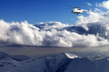 Helicopter in winter mountains