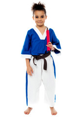Karate girl holding nunchucks