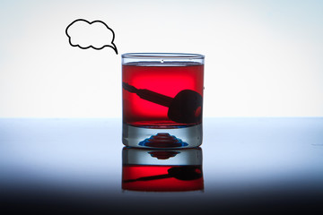 Alcoholic Drink with Car Keys concept drinking and driving