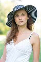 portrait of beautiful girl with striped hat