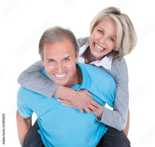 Mature Man Piggybacking His Wife