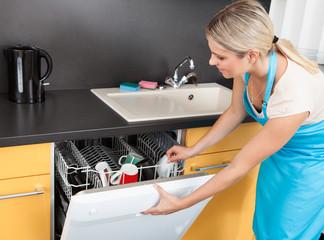 Woman Opening Dishwasher