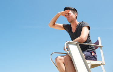 Male lifeguard looking out into the distance