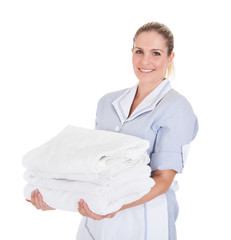 Happy Young Maid Holding Towels