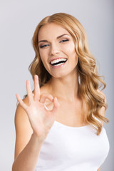 Young woman showing okay gesture